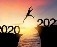 Silhouette man jumping from 2020 to 2021 cliffs